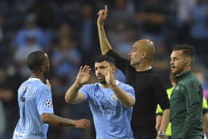 Manchester City's head coach Pep Guardiola points to his players as Sergio Aguero comes on.