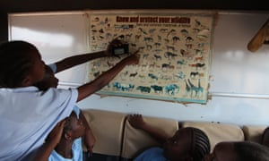 """""""This is what we saw!"""" Children discuss their sightings in the field during the Kids Twiga Rally."""