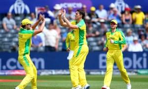 Pat Cummins of Australia celebrates with his teammates after dismissing Hazrat Zazai of Afghanistan
