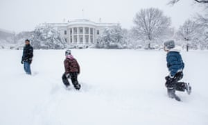 Obama plays with Sasha and Malia in the snow at the White House, 6 Feb 2010.