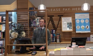 screens protect staff in a London branch of Waterstones.