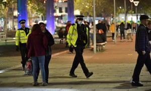 Police patrol in Bristol city centre, ahead of a national lockdown for England from Thursday.