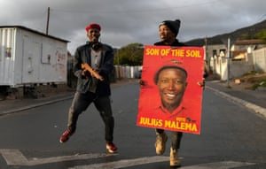 Supporters of the Economic Freedom Fighters party dance outside a polling station in Masiphumelele, Cape Town