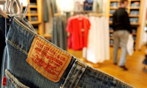 a pair of Levi jeans hangs in a shop
