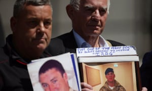 Relatives with photographs of British military personnel killed in Iraq