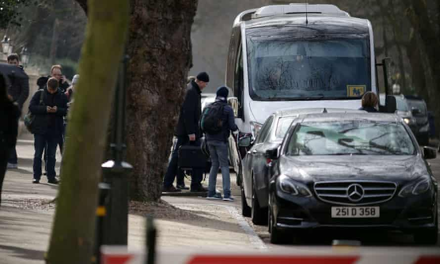 People leave the Russian embassy in London on Tuesday.