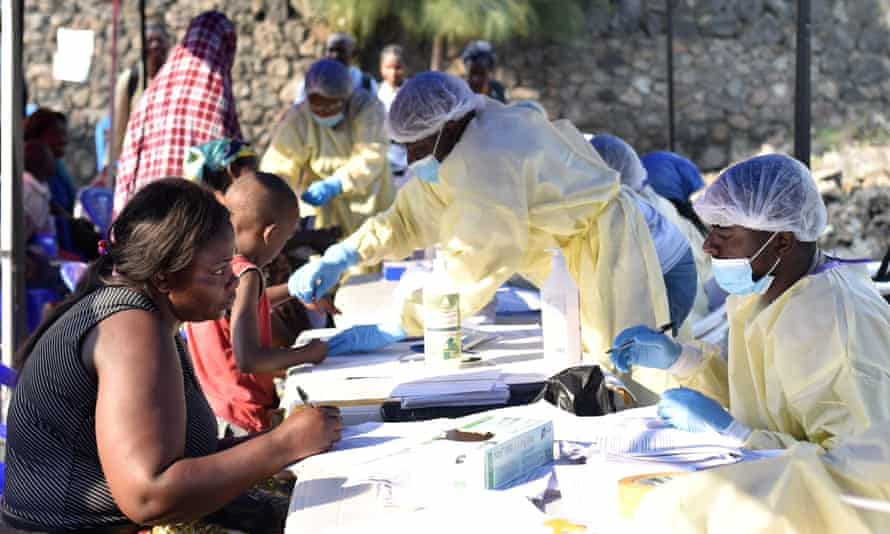 Congolese health workers collect information before administering Ebola vaccines at the Himbi health centre in Goma