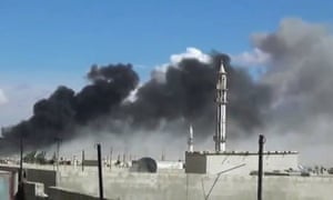 Smoke rising after airstrikes in Talbiseh