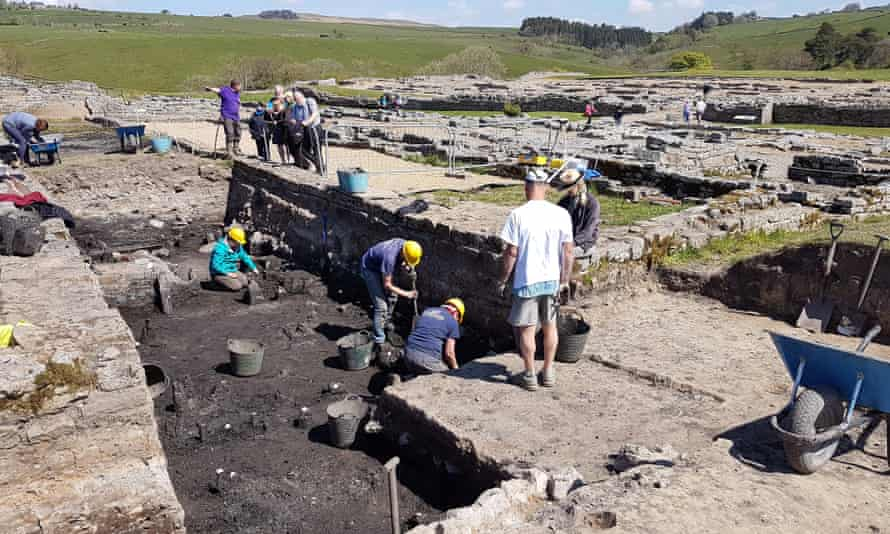 Archaeologists carrying out excavations on Hadrian's Wall - an area which has been particularly targeted by illegal metal detecting over many decades. Many archaeologists work in large open trenches.