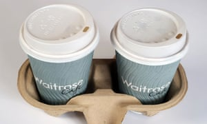 a pair of waitrose coffee cups in a cardboard harness