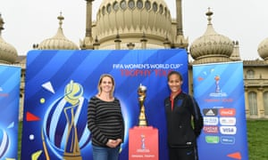 Kelly Smith (left) and Rachel Yankey pose with the Women's World Cup in Brighton.