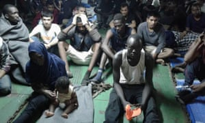 Migrants onboard the container ship Nivin. Many of them have refused to disembark in Misrata in Libya.