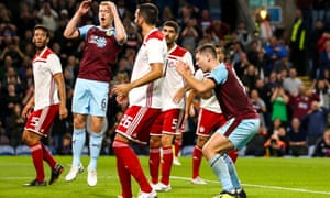 Sam Vokes (right) looks distraught after spurning another chance for Burnley on a frustrating night for the English side.