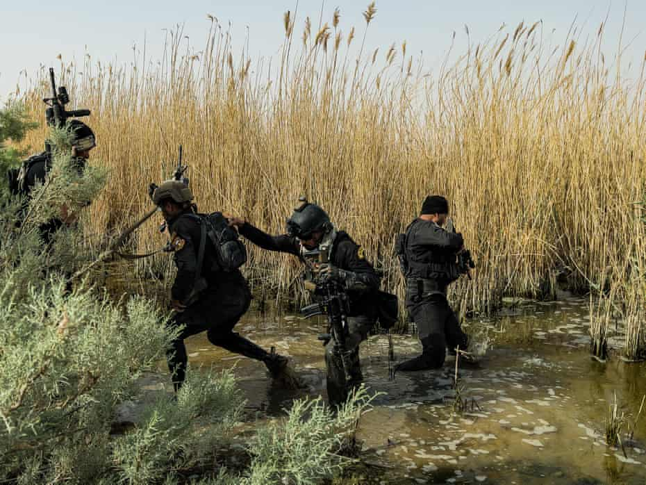 Members of the Iraqi special forces, Isof, search for Isis militants in irrigation canals south of Kirkuk.