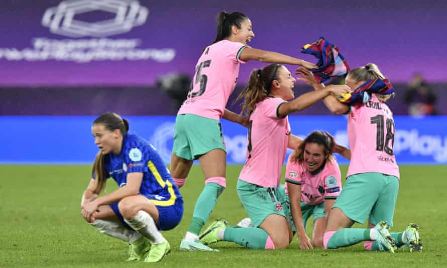 Chelsea's Fran Kirby drops to her haunches on teh final whistle while the Barcelona players celebrate winning the Women's Champions League in glorious style.