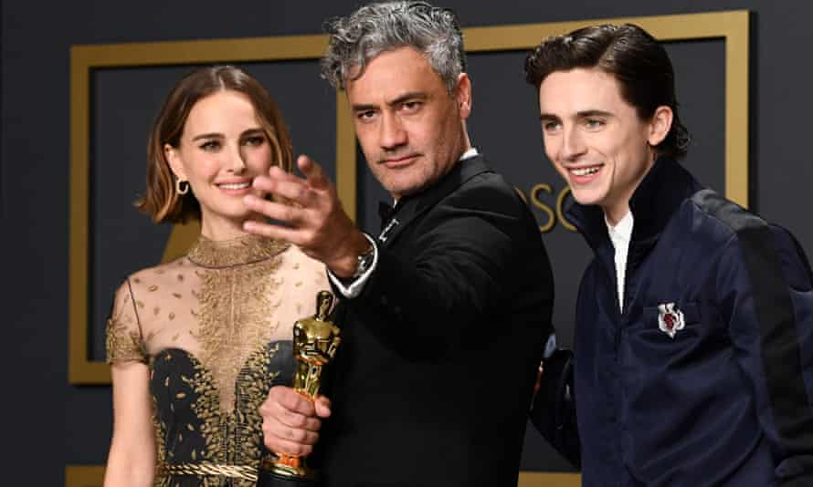 Taika Waititi with Natalie Portman and Timothee Chalamet at the Oscars