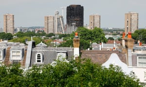 Signs of social division … Grenfell Tower block is seen behind town houses in affluent Notting Hill, west London.