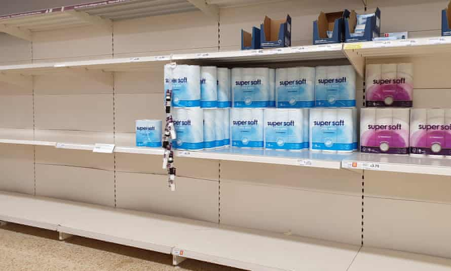 Almost empty shelves of toilet roll in a supermarket
