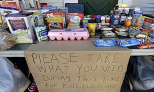 A community table is filled with groceries for those in need and impacted by the coronavirus in New Hampshire, US.