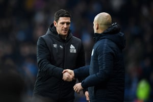 Mark Hudson shakes hands with Josep Guardiola after City's 3-0 victory.