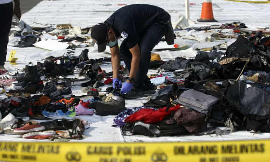 An investigator inspects debris from Lion Air flight JT 610 that crashed into the Java sea on Monday.