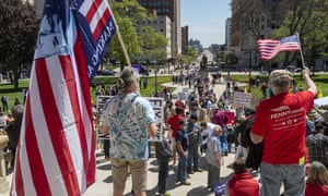 Protesters in Michigan oppose the state's stay-at-home order. Tea Party Patriots have spearheaded a drive to mobilize doctors urging states to move faster.