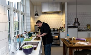 A chef in the kitchen at Josephine Schneider's House.