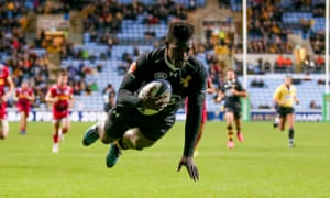 The Wasps wing Christian Wade prepares to touch down for his second try against Harlequins.