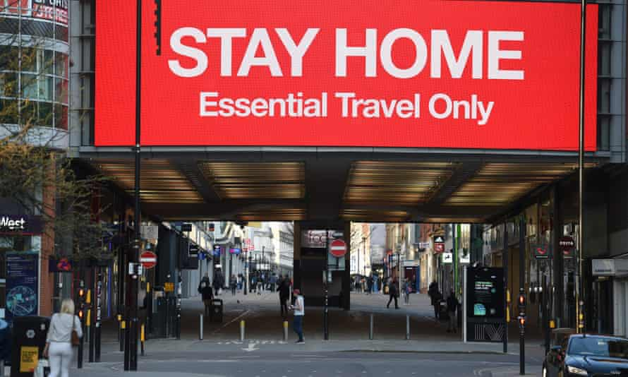 An information board displays a message asking people to 'stay home' in Manchester, on 27 March 2020.