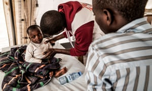 Victoire, one of 12 children in his family, is treated by a doctor in Bukavu
