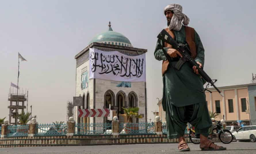 Taliban fighter stands guard at a checkpoint in Kandahar, Afghanistan, 17 August 2021.