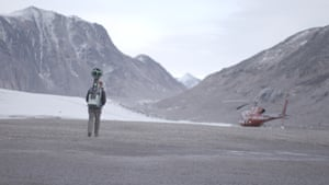 Expedition helicopter at the foot of a glacierThe land where Coster-Waldau is walking was covered by the glacier in previous years, an indication of the rate the ice is retreating.