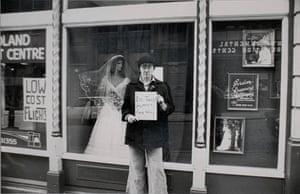 Person outside bridal shop