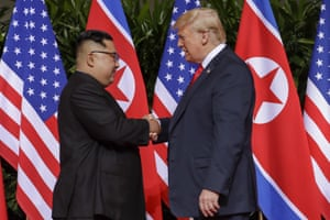 Trump and Kim shake hands to kick off their summit.