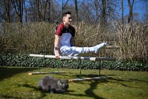 German gymnast Marcel Nguyen works on his parallel bars routine in his mother's garden in Unterhaching.