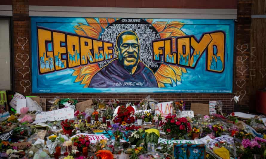 A mural and makeshift memorial stands outside Cup Foods where George Floyd was killed in Minneapolis.
