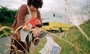 A farmer's wife used to leave her books in a bag in the hedge so the librarian, here Joanne Lacy, could swap them over without meeting her or knowing where she lived.