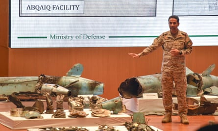 Lt Col Turki al-Maliki displays pieces of what he said were Iranian cruise missiles and drones recovered from the attack site.