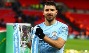 Sergio Agüero holds the Carabao Cup after Sunday's victory over Arsenal and will reach 200 goals for Manchester City if he scores at the Emirates on Thursday.