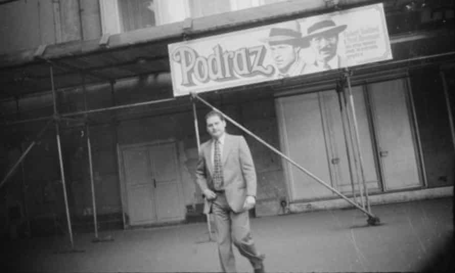 Carlos the Jackal pictured covertly in front of a billboard advertising a film called The Sting