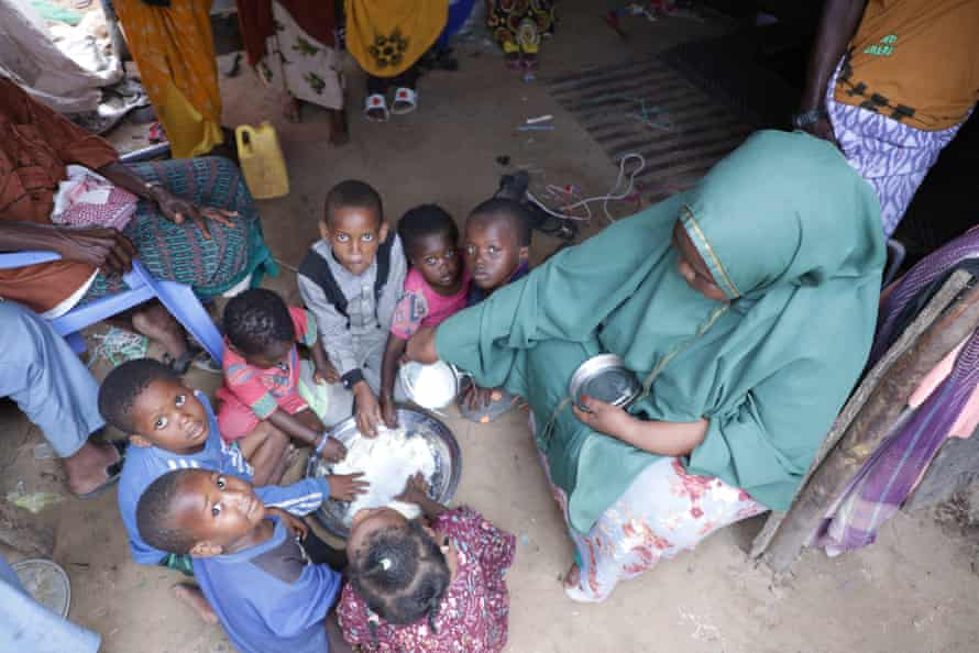Fadumo Ali Mohamed with her children in camp