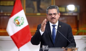 Peru's interim president, Manuel Merino, announces his resignation at the presidential palace in Lima on Sunday.