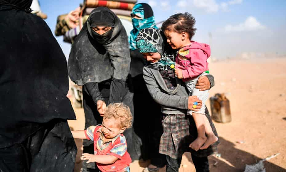 Displaced Syrians on the outskirts of Raqqa this week after fleeing the city of Deir ez-Zor.