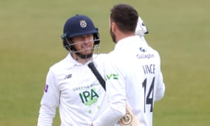 James Vince of Hampshire celebrates making 200 with team mate Liam Dawson, who himself made 152 not out.