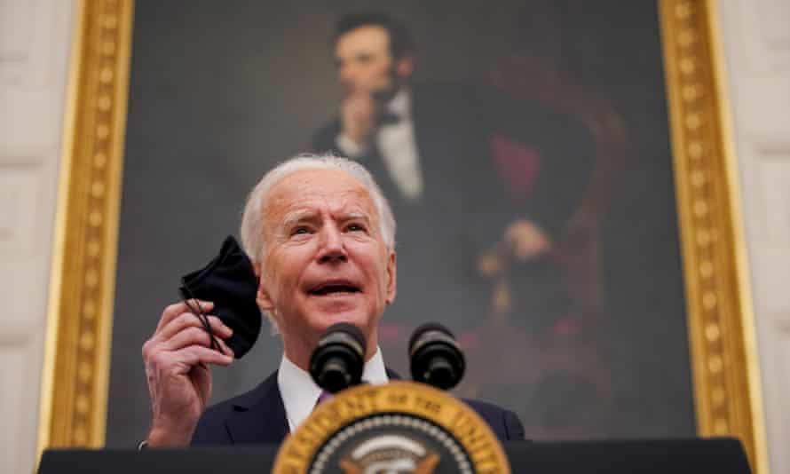 Joe Biden urges Americans to 'mask up' for 100 days as best way to curb the spread of the coronavirus.