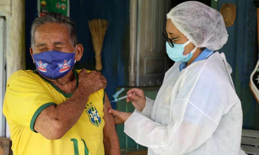 A 90-year-old man receives a Covid vaccine in Manaus, Brazil.
