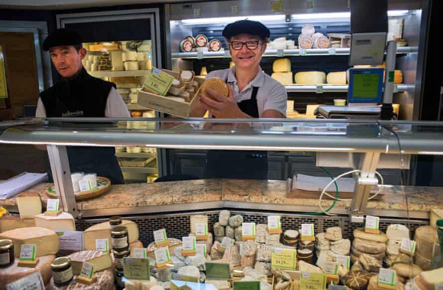 Cheese stall on the Marché de Talensac, Nantes, France.