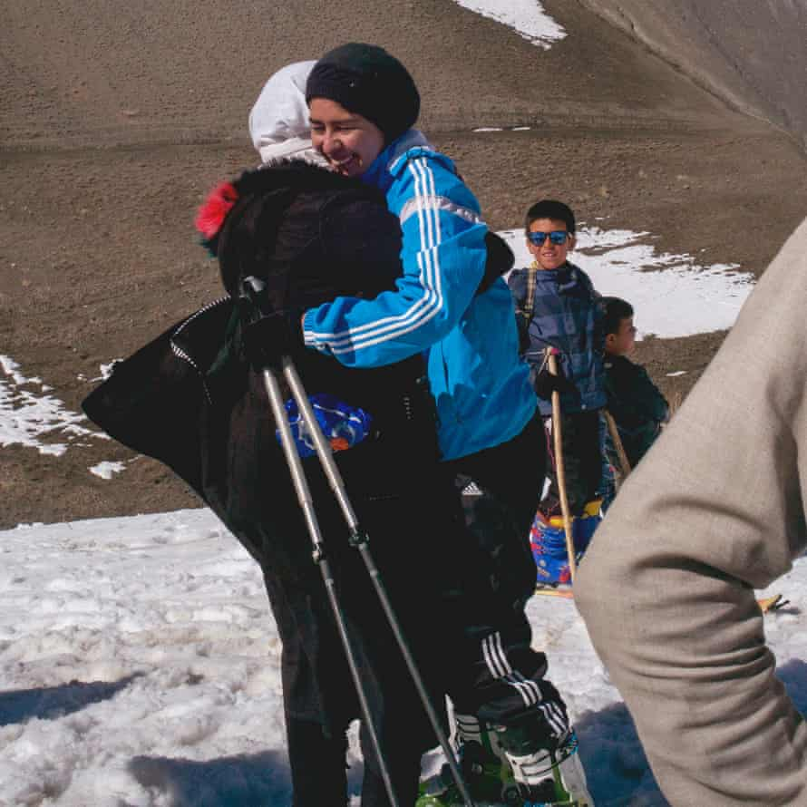 Nazira hugs a friend in celebration after realising she has won the Afghan Ski Challenge women's race