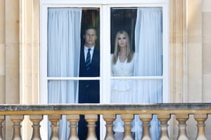 Jared Kushner and Ivanka Trump look out of a window at the palace