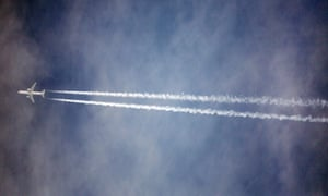 A plane in flight over Stansted Airport, in Essex, UK.